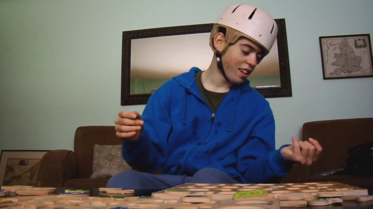 "Porter Bridges still wears diapers and a seizure helmet 20 years after getting his ""shots"".."